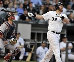 Adam Dunn tracks the flight of his first inning, three-run home run.