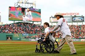 Jeff Bauman, accompanied by Carlos Arredondo, heads to the mound for an emotional first-pitch.