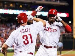 Domonic Brown gets a high-five from Erik Kratz after Brown's HR in the 4th. Moments Later, Kratz followed suit.