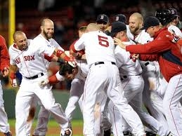 Stephen Drew gets mobbed by teammates following his game-winner.