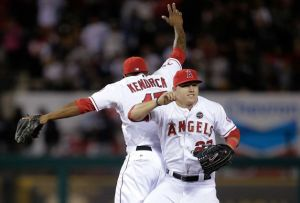 Howie Kendrick and Mike Trout celebrate after beating the Yankees 5-2.