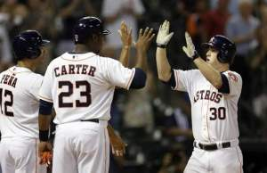 Matt Dominguez celebrates after his 7th inning grand slam. The Astros blow out the Brewers 10-1.