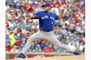 Mark Buehrle pitches 7 scoreless, and Blue Jays blank the Rangers 8-0.