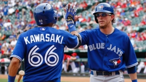 Colby Rasmus celebrates after his 2-run, 4th inning home run. Blue Jays beat the Rangers 6-1.