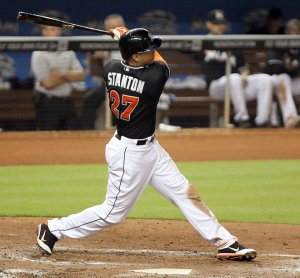 Giancarlo Stanton goes 3-4, doubles twice, and drives in 2 runs in the Marlins 5-4 win over the Cardinals.