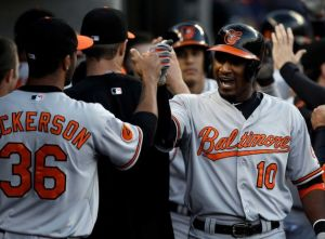 Adam Jones celebrates in the dugout after his 3-run homer in the 5th inning. The Orioles went on to beat the Tigers 5-2.