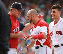 Shane Victorino's jersey hangs in tattered strips as he is congratulated by manager John Farrell following the walk-off error.