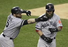 Jonny Gomes reaches out for the congratulatory beard-pull following Napoli's game-winning home run in the seventh.