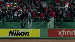 In an iconic image, Torii Hunter flips over trying to catch Papi's grand-slam in the eighth as bullpen officer Steve Horgan looks on in a triumphant pose.