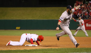 Mike Napoli celebrates over a dejected Kolten Wong after the latter was caught off first to end game four of the Series.